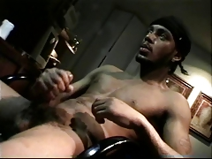 Black guy caressing his own dick