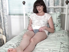 Kate Anne lays in bed stripping