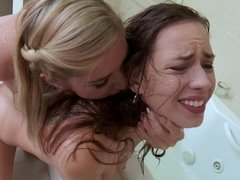 Two girls handle one another well in the bathroom today