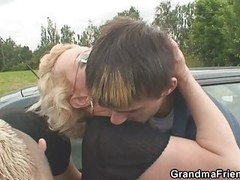 Old woman in the outdoor threesome