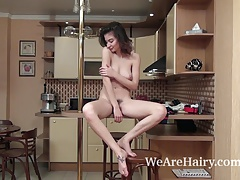 Taffy strips naked in her kitchen to enjoy herself