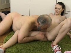 Old dude stuffs mouth of a young sweetheart with his penis