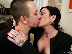 Inked Granny Susan loves young cock