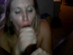 Sexy white lady gives head a large black dick