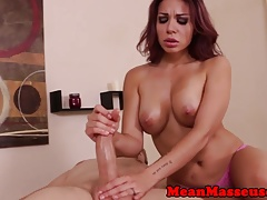 Redhead masseuse jerking and dominating