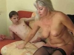 Young guy worshipping a aroused more experienced lady