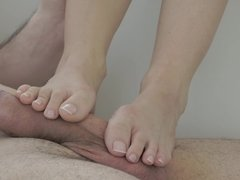 A blonde uses her sexy feet to massage a hard cock outdoors