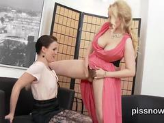 Sexy blonde babe pisses all over a horny lesbian girl