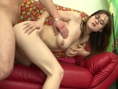 A brunette is getting her hair pulled as she is getting fucked hard