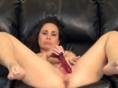 Holly West sends her fingers and a red dildo pleasing her aching twat