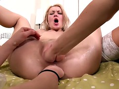 Lesbo assfisting on a coffee table