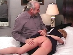 Innocent nice-looking blonde's bare bum gets spanked red with a yardstick