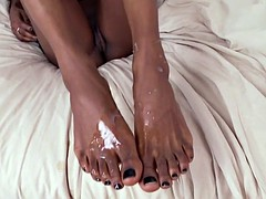 Foot loving babe wanks cock with her feet