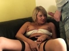 Submissive granny fingers her pussy