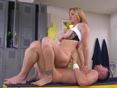 A sexy teacher is in the locker room, taking advantage of an athlete