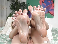 Hailey Reed rub lotion all over her sexy soles and toes