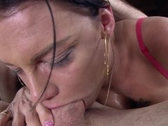 Woman with large fake tits is getting a creampie on her pussy