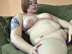 Curvy cutie Tiffany Blake uses a dildo on her tight twat