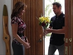 Bringing flowers to his champion buddy's mom