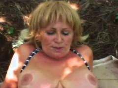 A slutty blonde granny rubs hr pussy then sucks