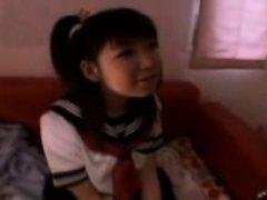 Pigtailed Japanese schoolgirl has a vibrator taking her sli