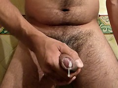 rubbing lotion on my hard uncut cock balls shaved