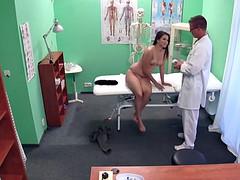 Doctor in uniform bangs cute patient