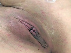 Masturbating babe uses dildo while in lingerie