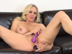 Striking blonde mom with big breasts Julia Ann drills her aching holes