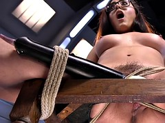 Bound hairy babe fucks machine