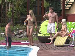 Two tanned blonde Euro babes fucking by the pool