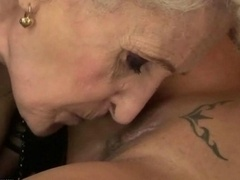 Granny and additionally young chick licking each alternative
