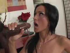 A bitch that has a sexy ass is sucking a big black cock here