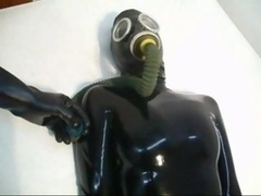 The No 1 Lesson For the no 1 time she wears a latex catsuit with mask & a gasmask with tube