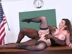 A curvy milf is getting a large cock in her pussy in the classroom