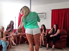 Girls are dancing around a pole and are getting naked