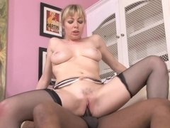 A blonde with a sexy pussy is getting fucked by a black hard cock