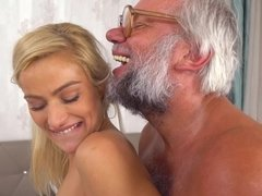 A blonde with natural boobs and a tight pussy is fingering her partner's ass