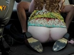 A redhead is in the car where she is sucking a hard large cick