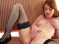 Redhead teases her cunt lips with her pretty hands in a solo video