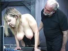 Mature man domme pulls plumpish sub's hair and moreover smacks her big tits