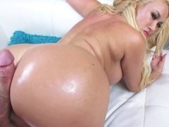 A chick is getting her oiled up tits fucked on the bed today