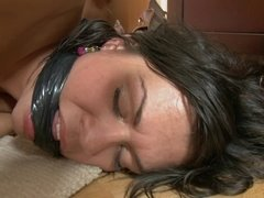 Stunning brunette is caressed with a toy during a bondage video