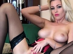 Sexy blonde in stockings and lipstick flashes her bald pussy