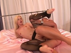 Blonde that has small tits is placing her feet on a cock to massage it