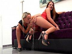 Stunning mistresses having a real wet golden shower