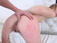 A blonde with natural tits gets her ass slapped and fucked