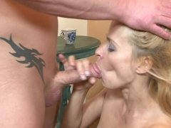 A blonde with a lusty body is placing her mouth on a big pecker