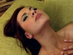 A big ass brunette with some nice tits is getting fucked in her pussy