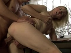 Curvy blonde granny with a nice pair of titties rides a big dick